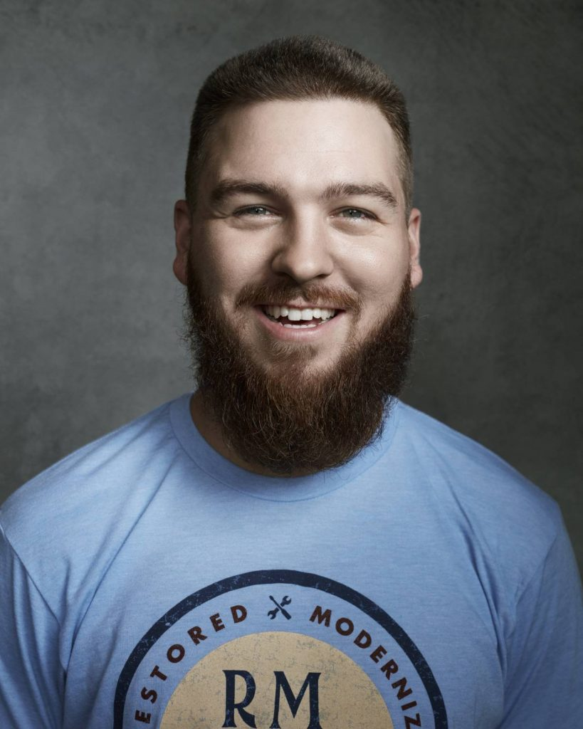 A portrait of Chance Leonard in front of a grey background
